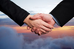Business handshake on a sky background Stock Photos