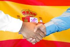 Handshake on Spain flag background royalty free stock images