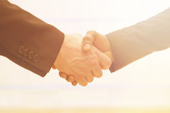 Business handshake with sun rays Royalty Free Stock Images