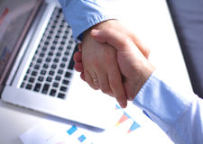 Business handshake. Two businessman shaking hands Royalty Free Stock Image