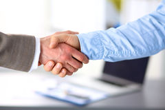 Business handshake. Two businessman shaking hands. With each other in the office Stock Image
