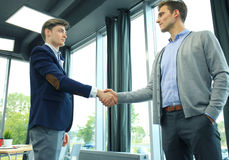 Business handshake. Two businessman shaking hands in the office. Royalty Free Stock Photography