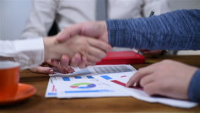 Business Handshake. Two Businessmen Shaking Hands. Handshaking After Good Deal. Slow Motion Effect stock video footage