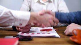 Business Handshake. Two Businessmen Shaking Hands. Handshaking After Good Deal. Slow Motion Effect stock footage