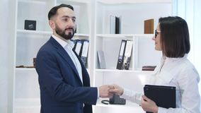 Business handshake - two businesspeople shaking hands to conclude deal or agreement.  royalty free stock image