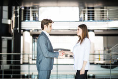 Business handshake - two businesspeople shaking hands to conclude deal or agreement. Business concept. Business handshake - two businesspeople shaking hands to royalty free stock images