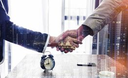 Business handshake. Two business people shaking hands in the of. Fice.Successful business people handshaking. Shaking Hands Agreement Concept.Lighting color Royalty Free Stock Images