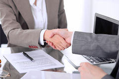 Business handshake. Two women lawyers are shaking hands after meeting or  negotiation. Royalty Free Stock Photo