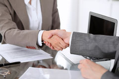Business handshake. Two women lawyers are shaking hands after meeting or  negotiation. Royalty Free Stock Images
