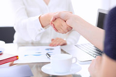 Business handshake. Two women are shaking hands after meeting or  negotiation. Stock Photos
