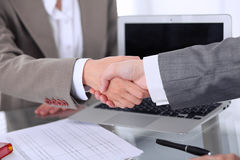 Business handshake. Two women are shaking hands after meeting or  negotiation. Stock Photography