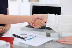 Business handshake. Two women are shaking hands after meeting or  negotiation. Royalty Free Stock Photos