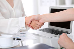 Business handshake. Two women are shaking hands after meeting or  negotiation. Stock Images