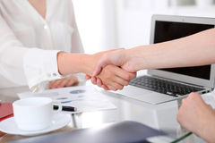Business handshake. Two women are shaking hands after meeting or  negotiation. Stock Image