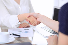 Business handshake. Two women are shaking hands after meeting or  negotiation. Stock Photo