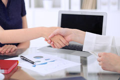 Business handshake. Two women are shaking hands after meeting or  negotiation. Royalty Free Stock Photography