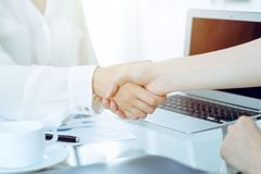 Business handshake after contract signing. Two women shaking hands after meeting or negotiation. Casual style of. Business handshake. Two women shaking hands royalty free stock image