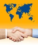 Business handshake under the world Royalty Free Stock Photos