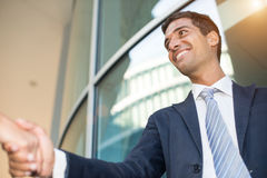 Business handshake: young businessman giving a handshake Royalty Free Stock Photos