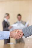 Business handshakes. Business people shaking hands in agreement stock photos