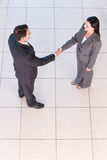 Business handshakes. Business people shaking hands in the workplace stock photo