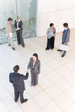Business handshakes. Business people shaking hands in business environment royalty free stock images