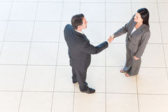 Business handshakes. Business people shaking hands in workplace stock photo