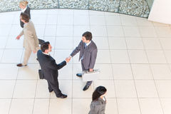 Business handshakes. Business people shaking hands in the workplace royalty free stock photography