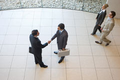 Business handshakes. Business people shaking hands in the workplace royalty free stock photo