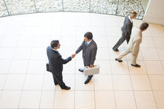Business handshakes. Business colleagues shaking hands in the workplace royalty free stock photo