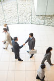 Business handshakes. Business people shaking hands in the workplace royalty free stock image