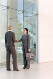 Business handshakes. Business women shaking hands in the workplace stock photo