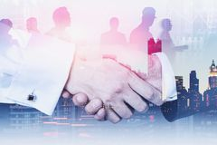 Business handshaking and corporate employees on New York skyline stock photos