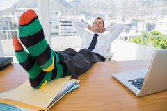 Business having a nap with feet on his desk Royalty Free Stock Photos