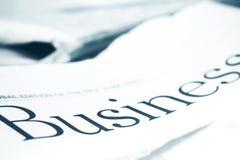 Business Headline. Business newspaper Headline, against strong backlight Stock Image