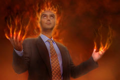Business in hell. Devilish businessman burning in hell Royalty Free Stock Images