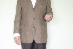 Business help concept. Photo for your design. The man in the jacket holds his hand palm up royalty free stock photography