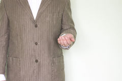 Business help concept. Photo for your design. The man in the jacket holds his hand palm up, pushing forward stock photos