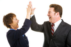 Business High Five. Enthusiastic business partners giving each other a high five.  Isolated on white Royalty Free Stock Images