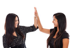 Business High Five. Two young mixed race business women giving high five for success isolated on white background Stock Photography