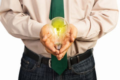Business holding a light bulb Stock Photo