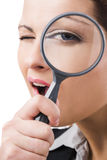 Business holding a magnifying glass Royalty Free Stock Photography