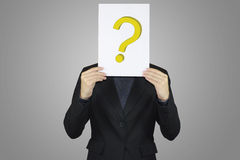 Business holding paper question mark sign. Royalty Free Stock Photography