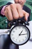 Business holding time for warning deadline Stock Photo