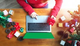 Business holiday online shopping concept. Business woman hand using laptop computer with blank screen on wooden desk, christmas and happy new year online Stock Images