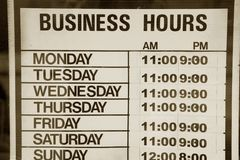 Business hours. Sign for background Stock Images