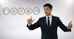 Business icons and Businessman touching air with hand gestures in front of white background Royalty Free Stock Photos