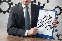 Business icons on clipboard Stock Image