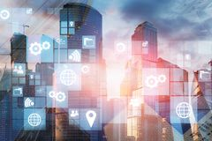 Business icons in modern city. White business icons interface over morning cityscape background. Concept of hi tech in business. 3d rendering double exposure stock images
