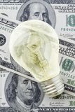 Business Idea. Light Bulb Over Banknotes Royalty Free Stock Photos